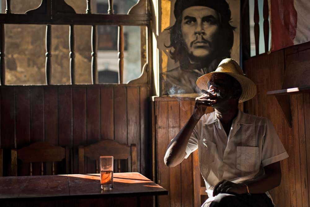 In a traditional bar in Old Havana, there's always time for a cigar. Photo by Danm12/Shutterstock.com
