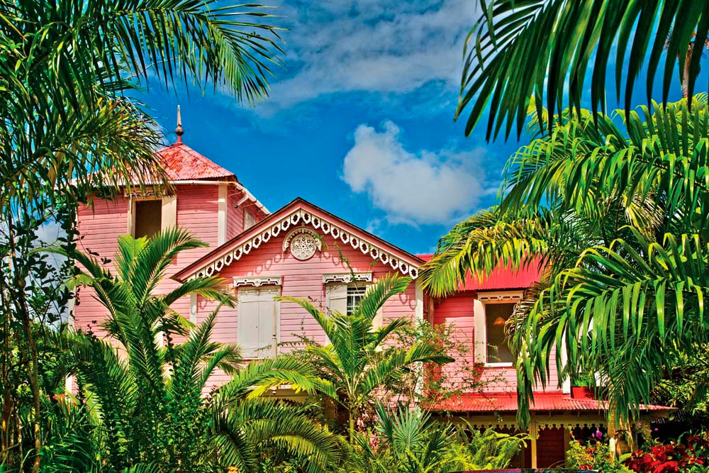 From its elevated perch on Morne Fortune, Pink Plantation offers amazing views of Castries Harbour, an orchid-filled garden, and a spectacular French creole menu (#thinkpink #historic #bringyourappetite). Photo by Danielle Devaux