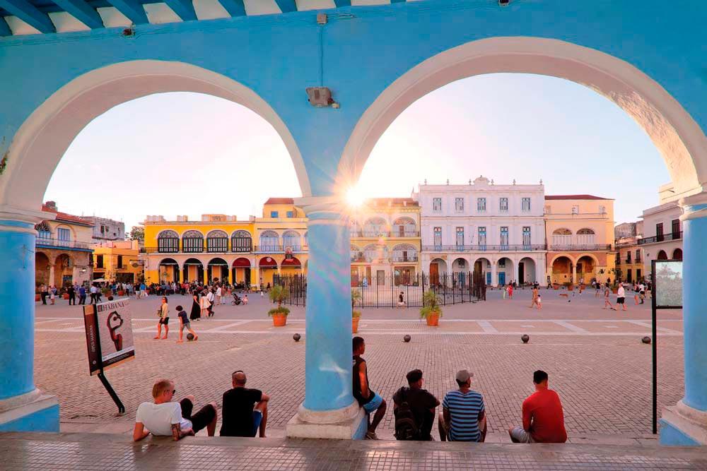 Passing the time in Havana's Plaza Vieja. Photo by Martin Thomas Photography/Alamy Stock Photo