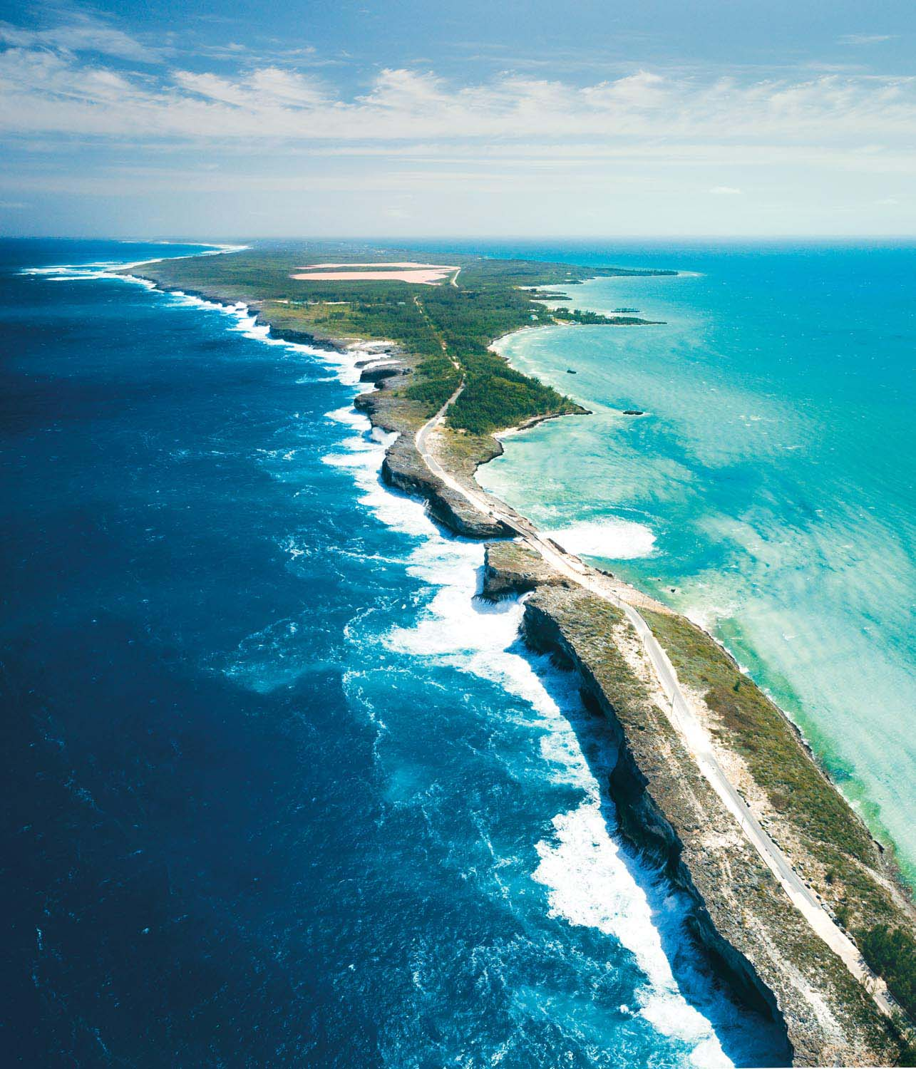 Eleuthera, accessible via a fast ferry from Nassau, is known for its broad pink sand beaches and the natural wonder known as the Glass Window Bridge. Here a narrow peninsula, just thirty feet across at one point, divides the deep blue of the Atlantic from the turquoise shallows of the Bight of Eleuthera. Photo courtesy The Bahamas Ministry of Tourism and Aviation