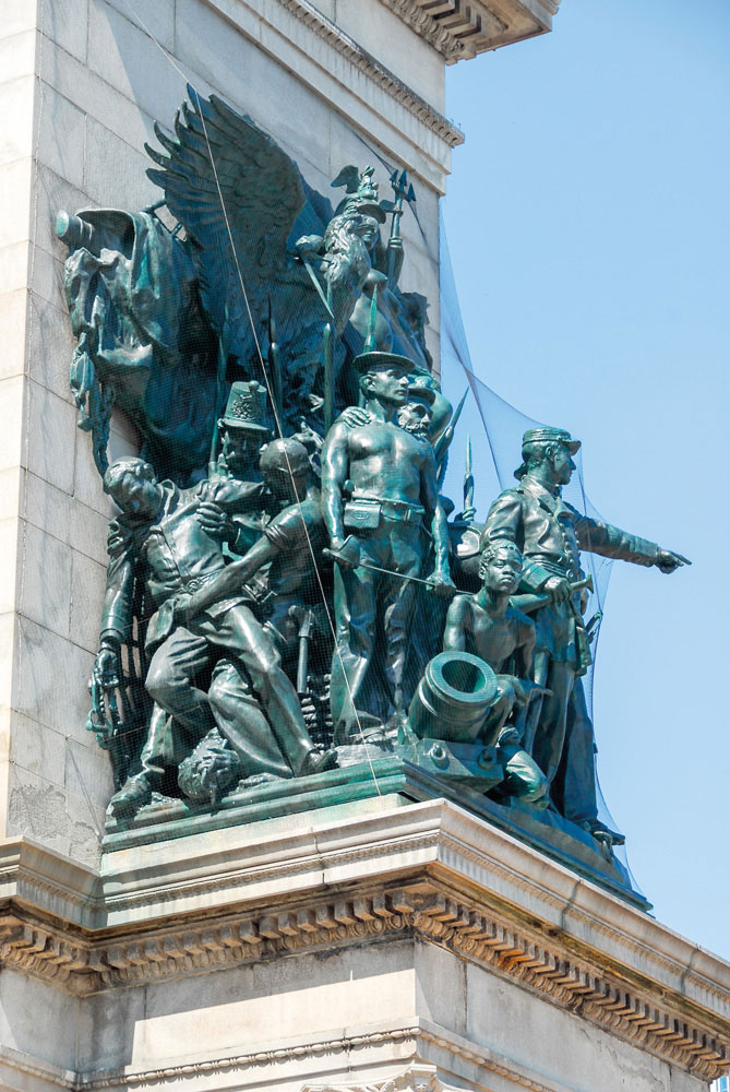 The bronze sculptures on the triumphal arch in Grand Army Plaza include a depiction of an African-American soldier. Photo by Felix Lipov/Shuterstock.com