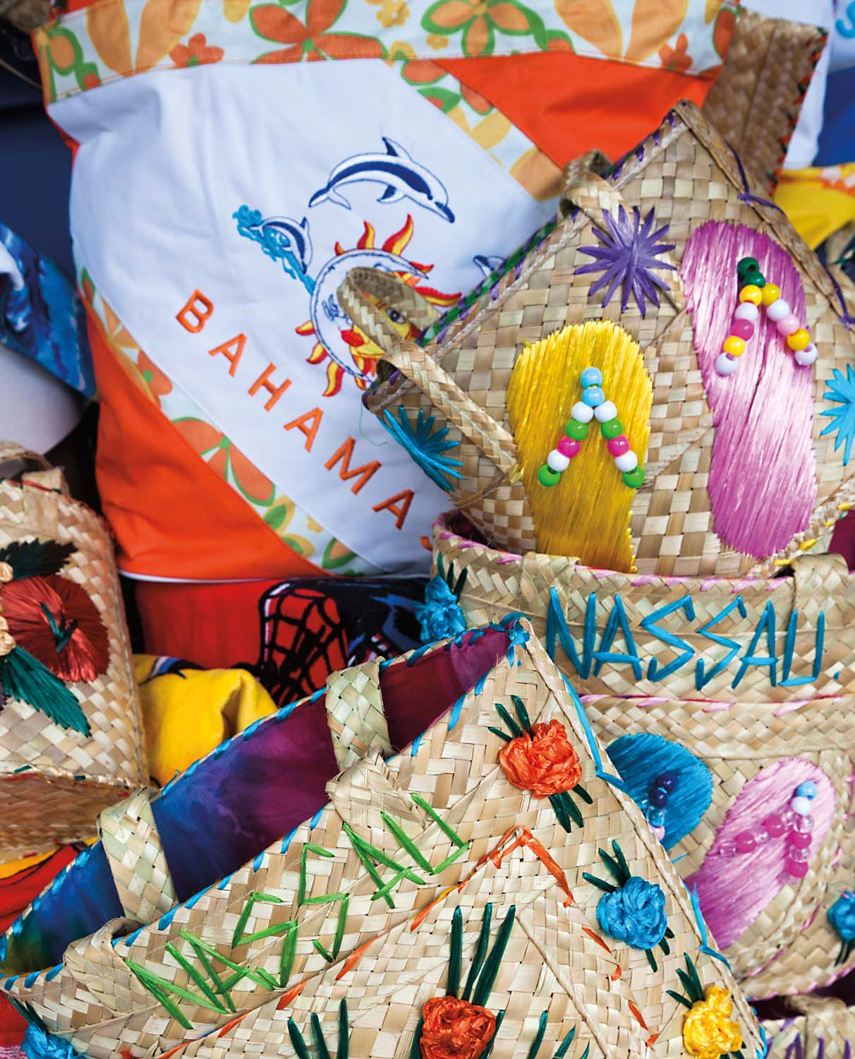 Colourful baskets are a typical souvenir on sale at the famous Straw Market in Nassau, capital of the Bahamas. Jon Arnold Images Ltd/Alamy Stock Photo