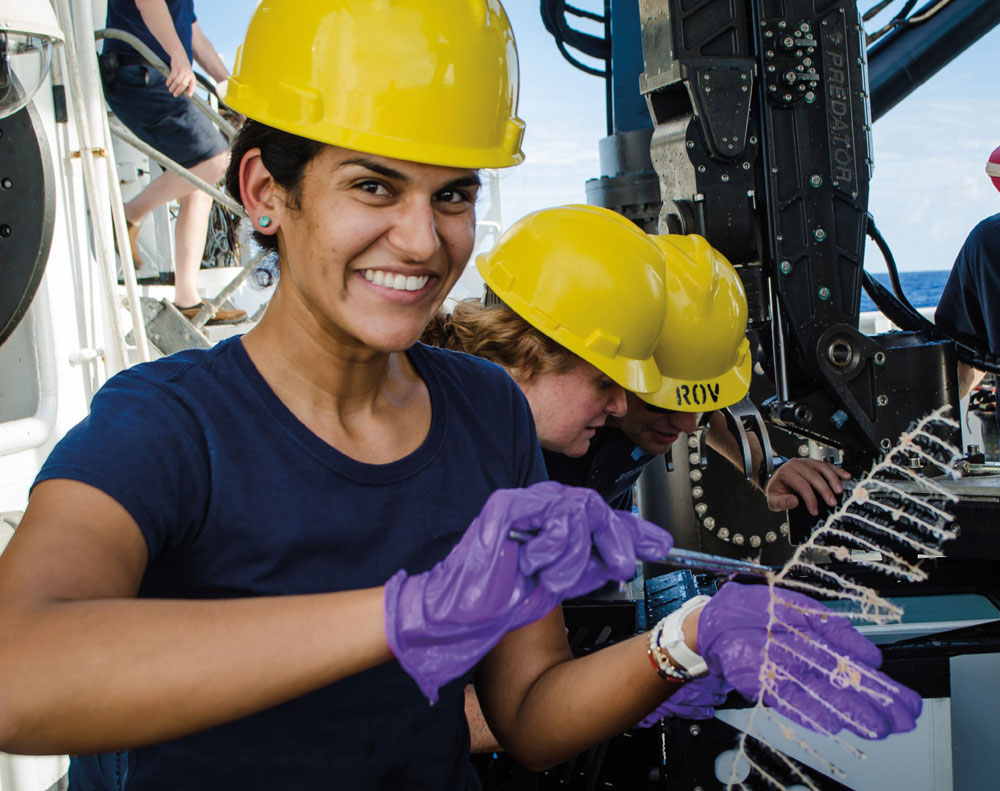 Diva Ammon retrieving a new species of deep-sea sponge collected from the Marianas region of the Pacific. Photo courtesy NOAA Office of Ocean Exploration and Research