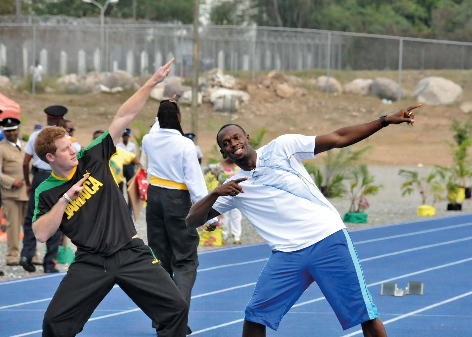 Prince Harry copies Usain Bolt's trademark move after their race in Jamaica earlier this year. Photograph by Aston Spaulding