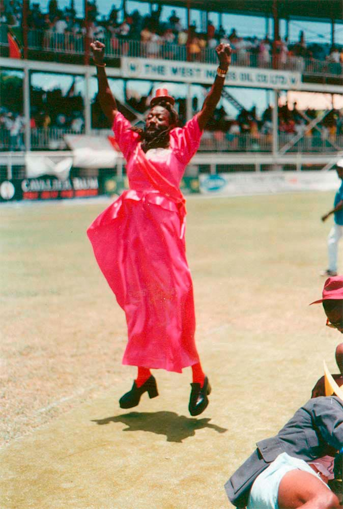 Cross-dressing Gravy entertains the cricket crowd at the Antigua Recreation Ground. Photo by Colin Cumberbatch