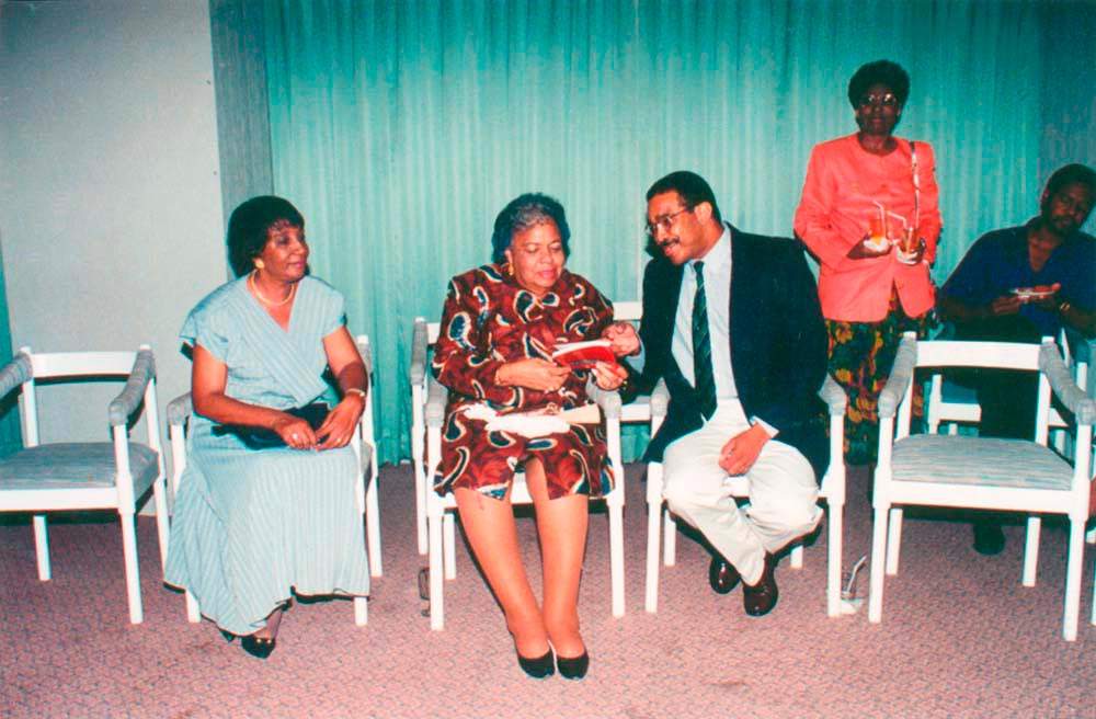 Randle with the late Dame Nita Barrow at the launching of An Area of Conquest: Popular Democracy and West Indian Cricket Supremacy by Hilary McD. Beckles