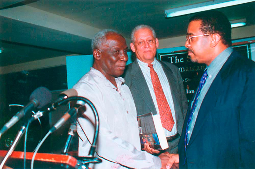With former Vice-Chancellor Sir Alistair McIntyre, centre, and present VC Rex Nettleford at the launching of The Story of the Jamaican People