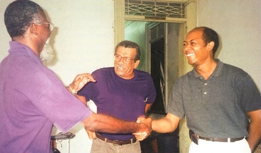 Peck with late Barbadian theatre director Earl Warner and Derek Walcott at Carifesta '95 in Trinidad. Photograph by Georgia Popplewell