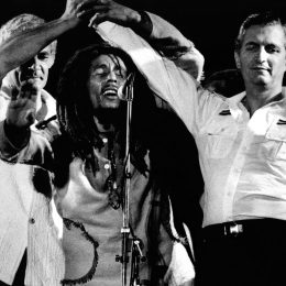 The famous moment: Michael Manley (left) and Edward Seaga (right) join hands at Bob Marley's insistence. Photograph by Urbanimagetv/ 56 Hope Rd. Music