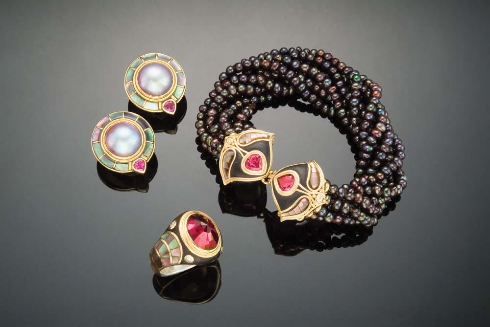 Bracelet of black seed pearls with garnet, gold, black mother-of-pearl, ebony, and diamonds; garnet, gold, black mother-of-pearl, ebony, and diamond ring; garnet, gold, black mother-of-pearl, and grey mabé pearl earrings. Photo by Michele Jorsling