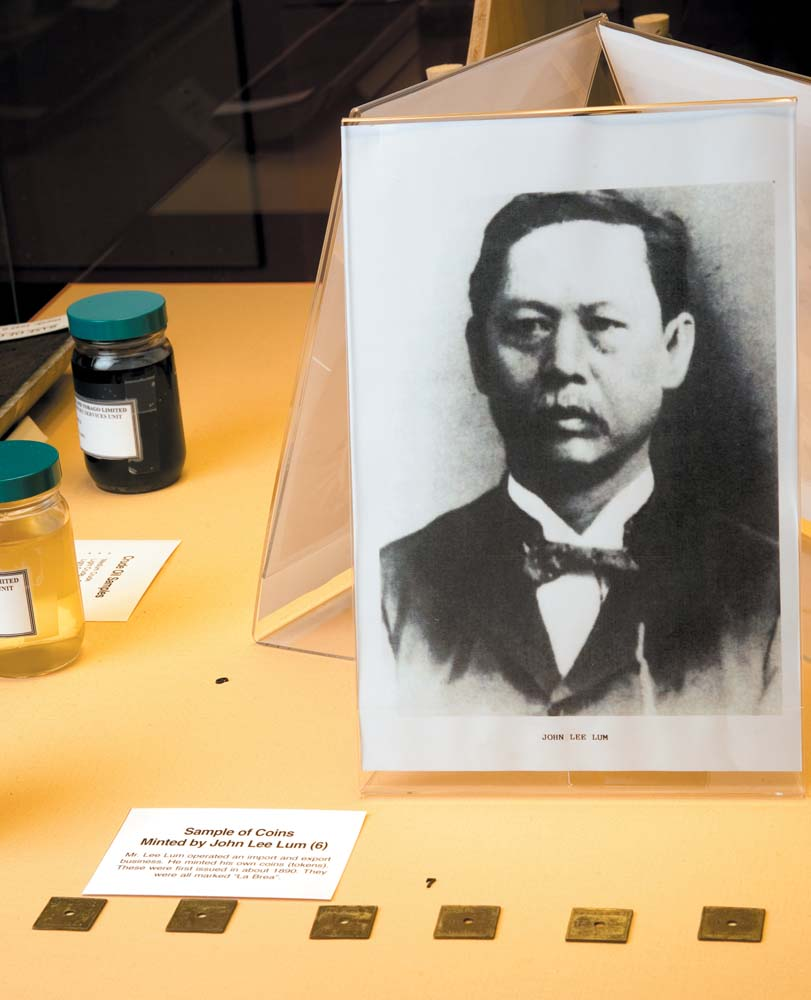A display on the Trinidadian oil pioneer John Lee Lum, who minted his own money — square metal tokens — in the early twentieth-century. Photo by Mark Lyndersay