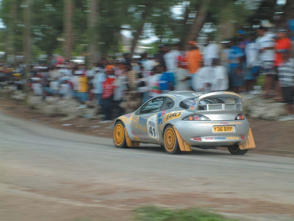 Andrew Hurley's Ford Puma Evo blasts through the stage at Duck Pond during Rally Barbados 2005. Photo by Narend Sooknarine/Zorce.com