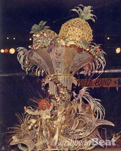 Queen of Carnival 1975: Joan Massiah portraying the Hawaiian Seafood Cocktail from A La Carte. Photograph by Noel Norton