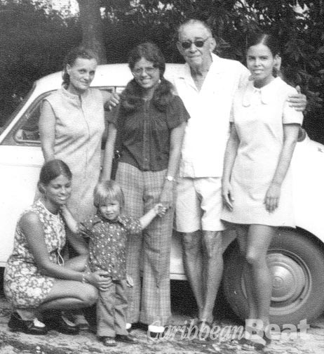 Collymore with his family- second wife Ellice (standing far left), daughters Annabel and Petra, daughter Martine (stooping) and grandson Barry