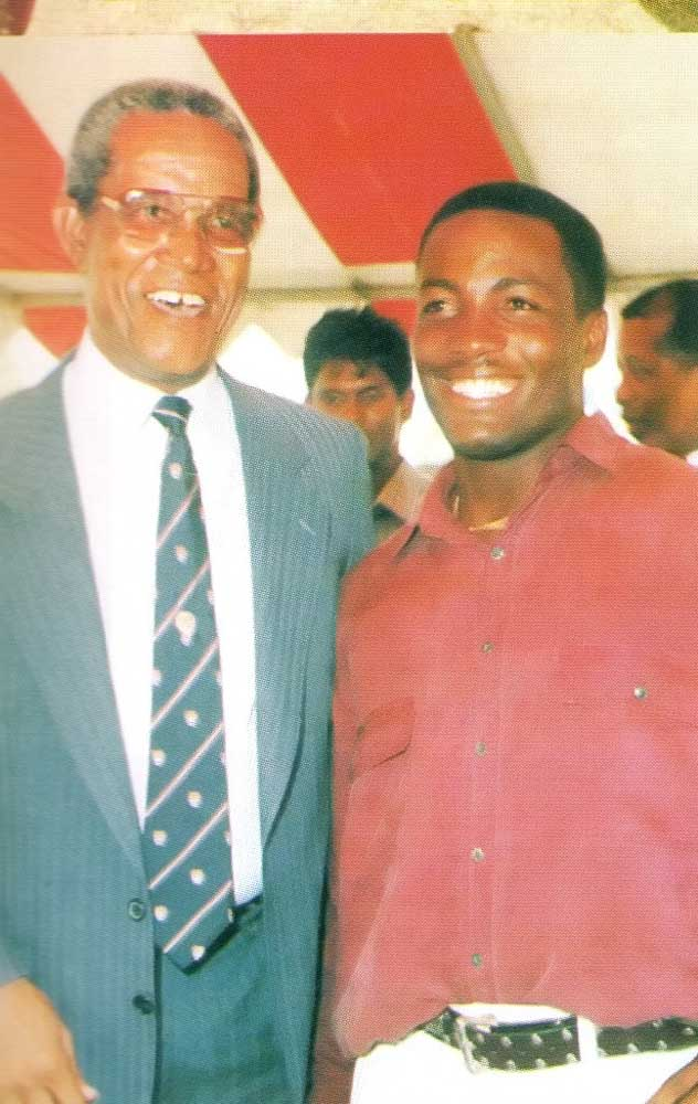 Lara with Sir Garry Sobers, whose record he broke. Photograph by Bertrand De Peaza