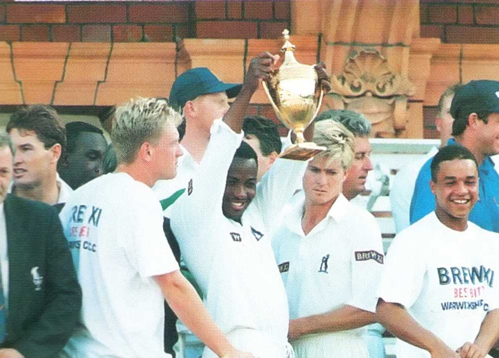 Lara raises the trophy after Warwickshire beat Surrey in the final of the Benson and Hedges Cup at Lords in July. Photograph by Adrian Murrell/Allsport
