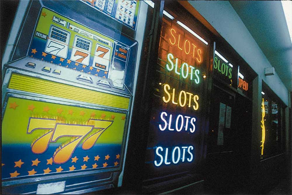 The florescent glow of local betting spots lures gamblers homeward. Photograph by Sean Drakes/ Blue Mango