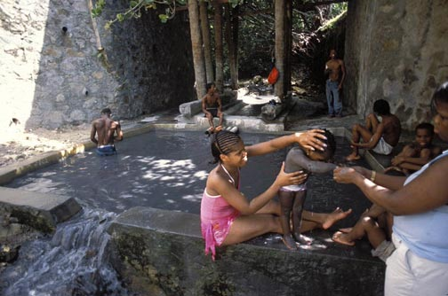 A St Lucian family enjoys the mineral waters at the Sulphur Springs. Photograph by Mark Lyndersay