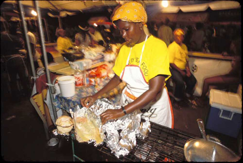 Preparing fish at the Saturday night food fiesta in Dennery. Photograph by Mark Lyndersay