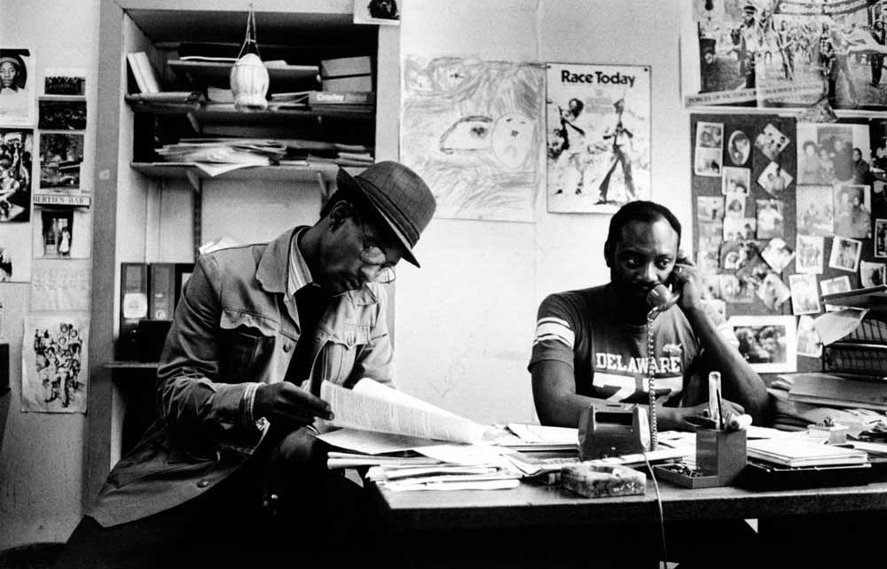 At the offices of Race Today in 1991, with Darcus Howe (at right). Photograph by Urbanimage.tv