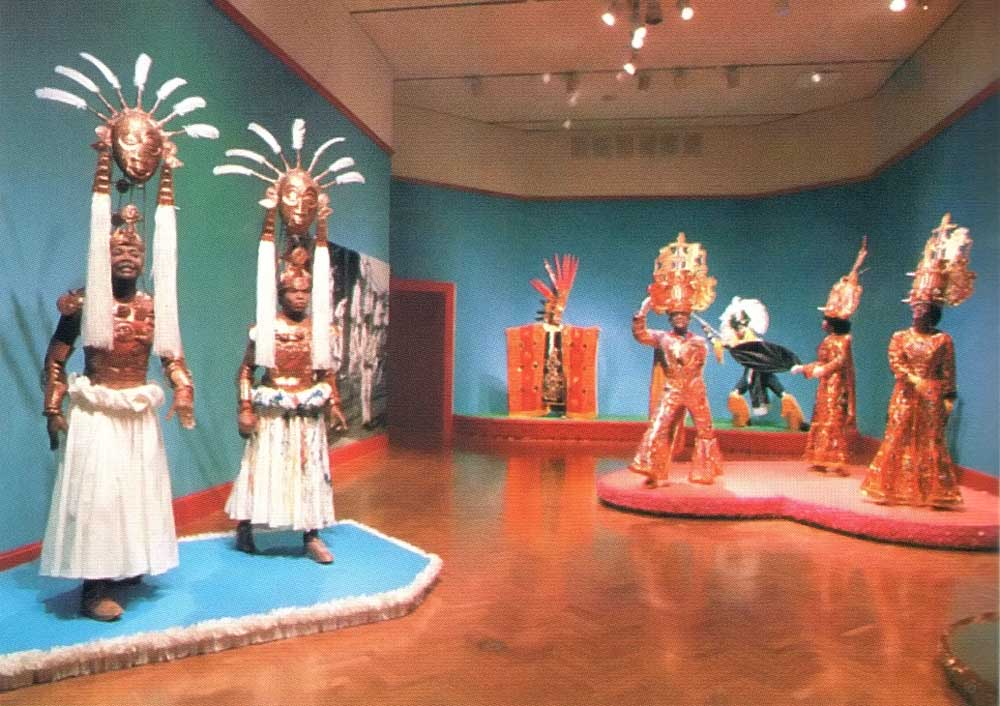 Carnival figures ath the Caribbean Festival Arts Exhibition in St Louis, Missouri. Photograph by Rex Nettleford