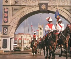 Barbados mounted police ride through Bridgetown's Independence Arch. Photograph by Eleanor Chandler