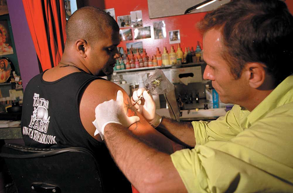Budin at work on the author. Photograph courtesy Tattoo Farm/ Alexis Smailes