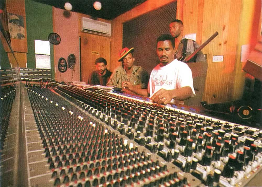 Part of the Marley legacy: in the legendary Tuff Gong studio in Kingston, Jamaica, Chalice bandleader Wayne Armond (left) works with producer Clive Hunt and engineer Errol Brown. Standing behind them is guitarist Mikey Fletcher. Photograph by Louis Davis