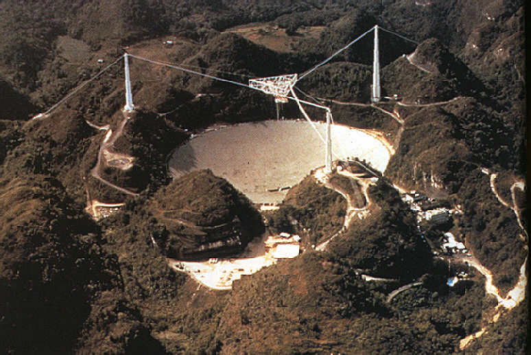 The massive reflecting dish at the Arecibo Observatory can be seen clearly from a jumbo jet at 33,000 feet. Photograph by the National Astronomy and Ionosphere Centre
