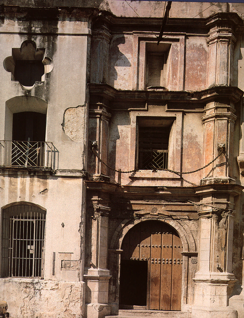 The main entrance of El Convento de Belén. Built in the early 18th century and now being restored, the covent also serves as living quarters for specialist craftsmen working on the city's buildings. Photograph by Martin Charles