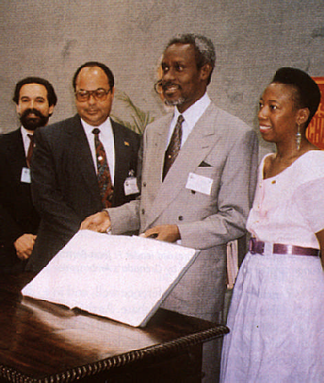 Jamaican Prime Minister P. J. Patterson after signing the Convention on Climate Change; on his right is the Jamaican environment minister John Junor