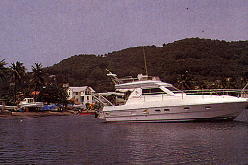 Bequia: boats for work, boats for play. Photograph by Jenny Bailey