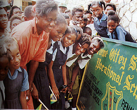 Merlene inspects the new signboard for her old school, renamed in her honour. Photograph by Michael Gordon
