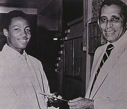 Lara receives an award from his mentor Joey Carew. Photograph by Trinidad Guardian