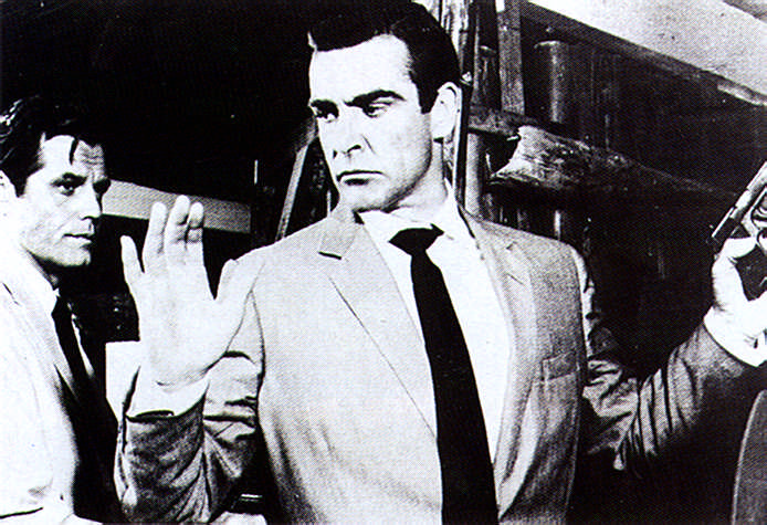 James Bond in the villain's power (though not for long) in Dr No. Ian Fleming was at first wary of casting the young Scottish actor Sean Connery as Bond, but after this movie he was completely won over. Photograph by British Film Institute