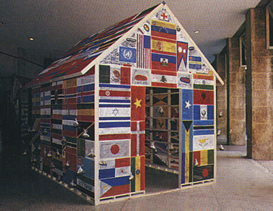 New York-based Venezuelan artist Elba Damast created a house made out of national flags, containing samples of dirt labelled with countries names. Photograph by Christopher Cozier