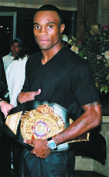 """""""Vivacious"""" Vivian Harris shows off his championship belt. Courtesy Staboek News"""