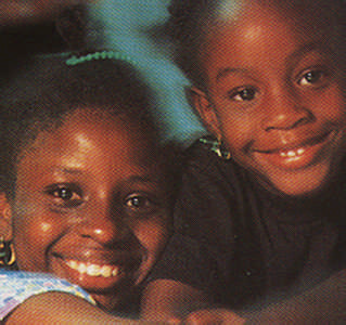Two of Tobago's many angelic smiles. Photograph by Allan C. Weisbecker