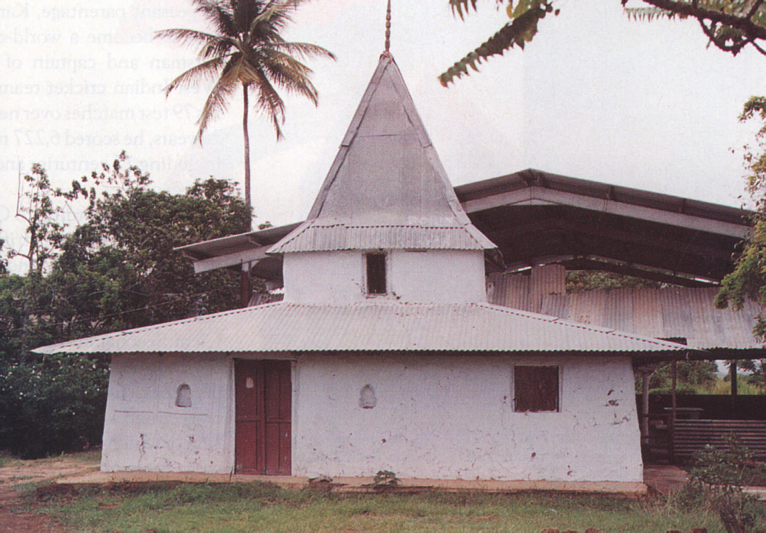 An early HIndu temple at Exchange Village, Trinidad: the original dirt walls and floor survive after more than a century. Photograph by Jai Parasram