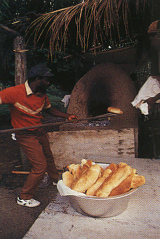 Baking bread in a traditional oven. Photograph by Noel Norton