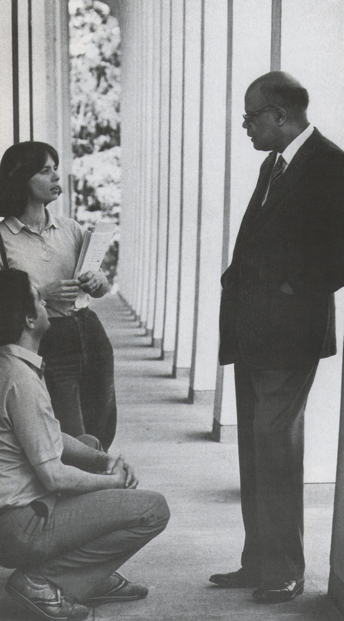 Lewis deep in discussion with Princeton students. Photograph courtesy J. T. Miller