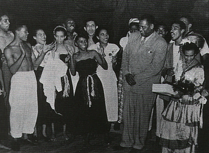 Blushing at the applause on the opening night of the Little Carib Theatre flanked by Melina Scot and Paul Robeson. Photograph courtesy Beryl Mc Burnie
