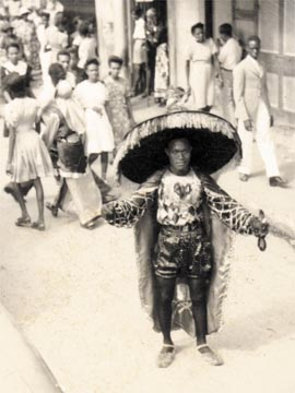 Midnight robber in downtown Port of Spain, c. 1940. Photograph from the Collection of Russel Halfhide