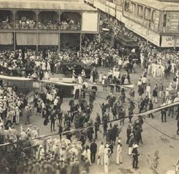 Carnival in the 1920s, at Marine Square in Port of Spain: sailors, devils, imps, and hundreds of onlookers. Photograph from the Collection of Adrian Camps-Campins