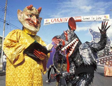 Bookman and dragon, Carnival 2000. Photograph by Bertrand De Peaza