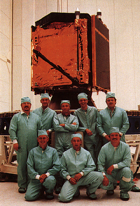 "The INMARSAT satellite core team, arrayed in ""noddy suits"" including satellite engineers Andrew Davidson (back row, centre) and James Mcllwaine (front row, right). Photograph by British Aerospace"