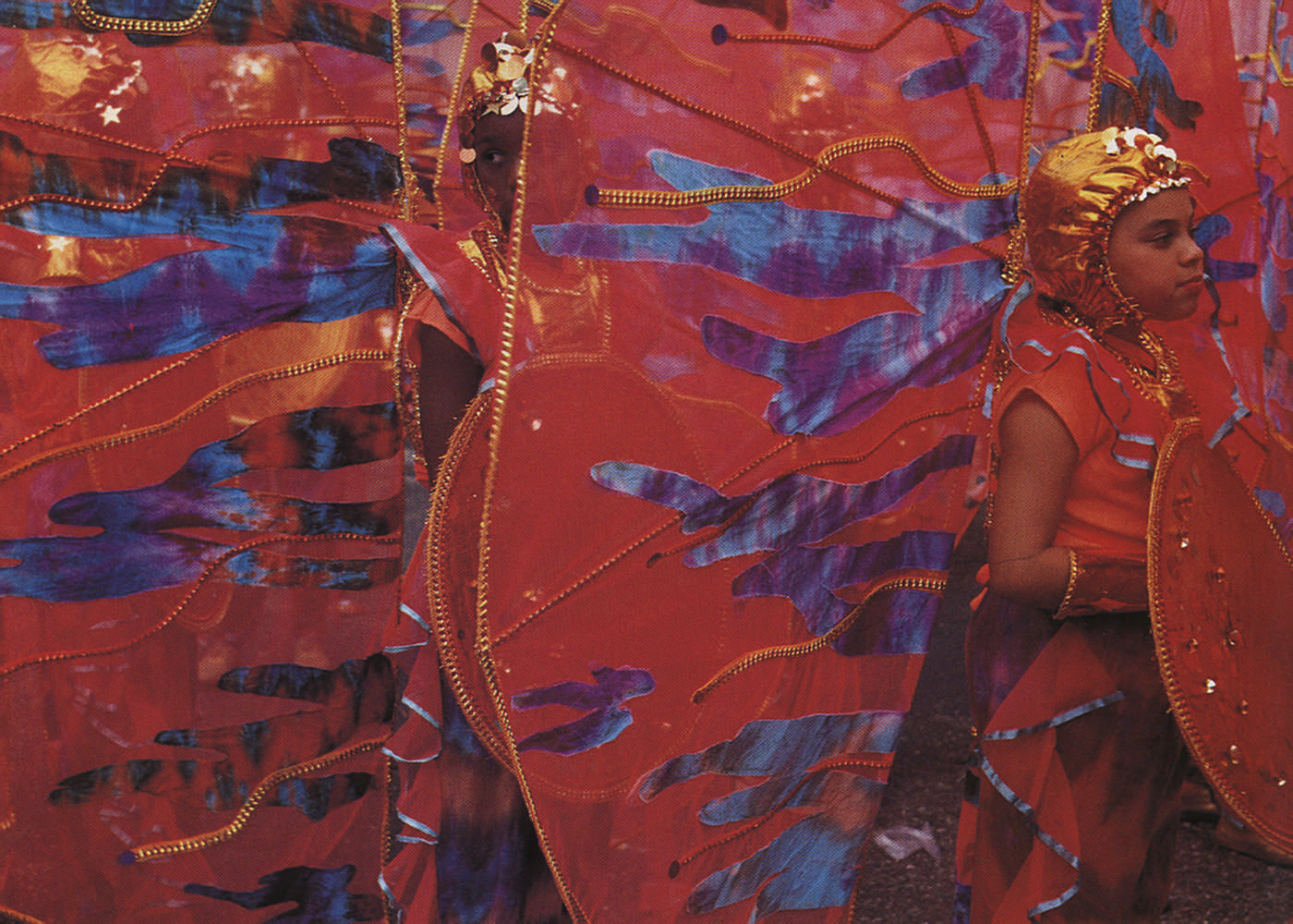 Orange sunset: young masqueraders from Ricard Bartholomew's 1994 Junior Carnival winner The Rainbow That is Real. Photograph by Bertrand de Peaza