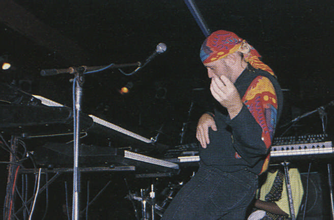 John Roett leaves the keyboards for an air guitar solo. Photograph by Roxan Kinas