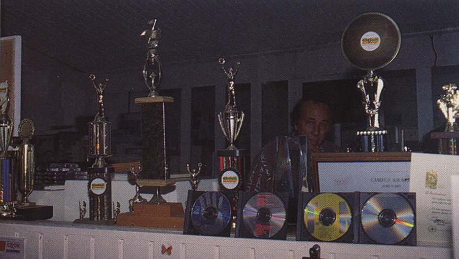 Lurking behind Spice's trophies, Emil Straker, father of Dean, and founder and member of the Merrymen. Photograph by Roxan Kinas
