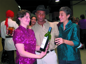 Sophie Meyer (left) and Dominique Le Grendre (right) right with parandero Cristo Adonis at the premiere of Salt of the Earth. Photograph by George Popplewell